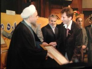 Babak Zanjani (re.) ist für Präsident Hassan Rouhani (li.) kein Unbekannter